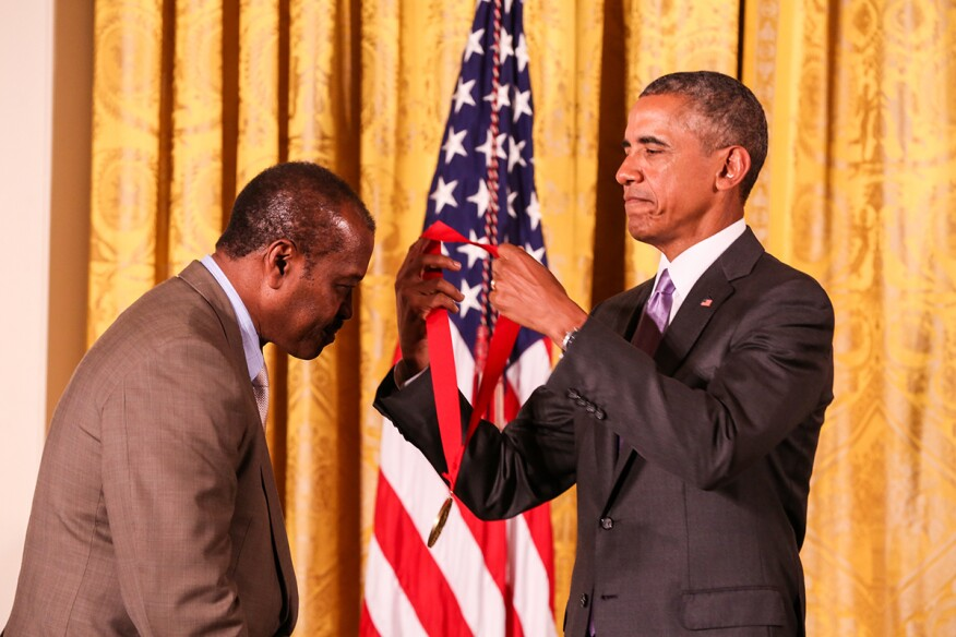 President Barack Obama (right) presents Everett Fly (left) with a 2014 National Humanities Medal.