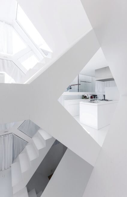 White-painted plaster board covers most of the M.C. Escher–like interior. Hard surfaces are countered by the perimeter curtains and in some spaces by hemp carpet.