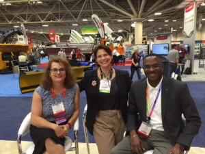 Jennfer Hughes and Eric Dargan graciously allowed me (in the middle) to tag along with them as they checked out American Public Works Association convention exhibitors.