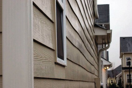 Exterior sheathing can buckle when it dries. Plywood, OSB and fiber board are all affected, and the the defect telegraphs to the siding. Photo: Steve Easley