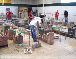 """Block laying is the first subject tackled in the one-year masonry program because it gives the students """"an immediate sense of accomplishment,"""" according to instructor Todd A. Larson."""