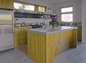The kitchen features cabinets milled from trees on the home's property and energy-efficient appliances.