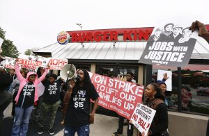 epa04208067 People picket during a 'strike' at a Burger King fast food restaurant demanding higher wages in Atlanta, Georgia, USA, 15 May 2014. Fast food workers and labor activists held similar demonstrations in other US cities, asking for a fifteen US dollars an hour wage.  EPA/ERIK S. LESSER ORG XMIT: ELX28