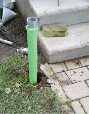 Figure 12. Because helical piles don't disturb the ground much, they can be installed alongside existing landscape features. Photo credit: Greg DiBernardo
