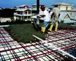 Lane Thompson Construction, Rosemary Beach, Florida, uses post-tensioning to achieve long, clear spans on the second floor deck-slab in this ICF home in Florida.