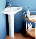 Porcher's Carene corner pedestal sink bowl is 12Ω inches deep from back to front.