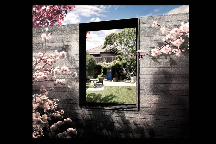 Arriving at The French Laundry's courtyard, guests will be greeted by the scent of California almond blossoms. A view through the stone wall will reveal the historic original building and its iconic blue door.