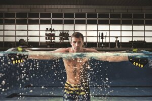 Rippling Effect: Speedo FIT's marketing campaign features striking imagery such as Olympian Ryan Lochte seen here using Clutch Paddles, one of several products in the brand's line of water workout gear.