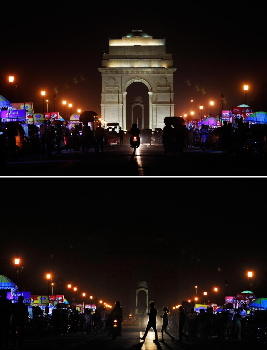 Top: The landmark India Gate lit up; Bottom: The same location in darkness when the lights are turned out for one hour to mark Earth Hour, in New Delhi, India, Saturday, March 29, 2014. Earth Hour is a global call to turn off lights for 60 minutes to highlight the global climate change.