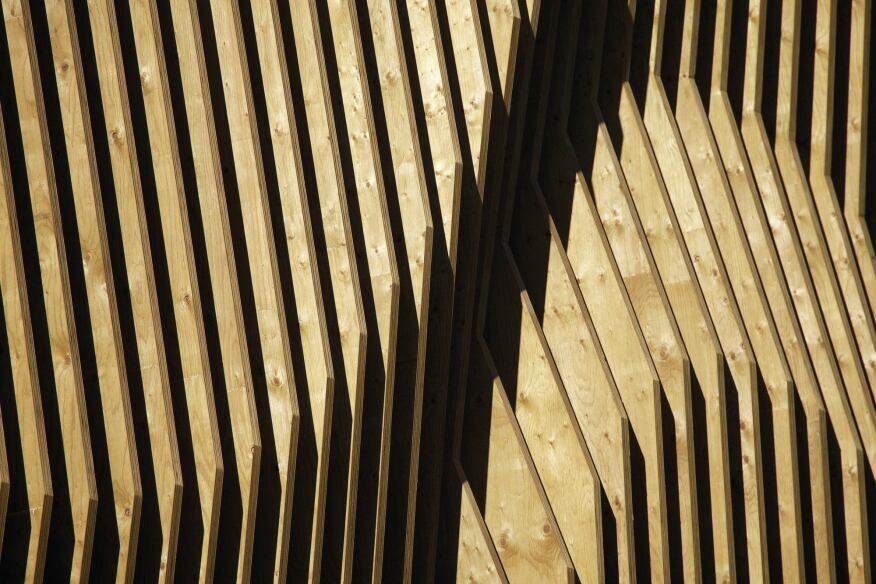 Each fin has a unique shape and contributes to the undulating pattern that becomes the building's seemingly continuous outer skin.