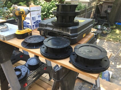 To account for the slope of the roof, Bison Versadjust pedestals are available in different sizes, each with a range of adjustment. They also have angled bases that can be rotated to provide a perfectly flat surface to support the deck panels.