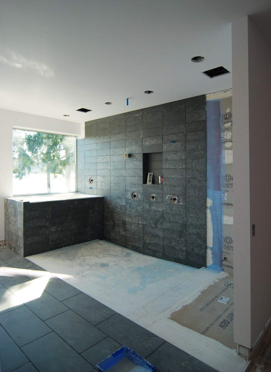 Mastering the curbless shower custom home magazine design this 4 floor drop is then lined with a single ply water proof membrane and filled with a concrete slab sloped to a single trough drain at one end dailygadgetfo Image collections