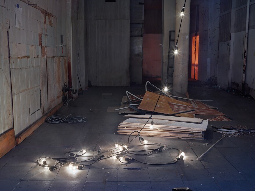 """String of Lights, Harlem, New York City""""I was outside this storefront peering into the window with my camera. The string of lights left there in this haphazard way looked to me like a found sculpture. I knew I needed to take the photograph immediately because the cleaning team would probably take it away the next morning. """" -- Lynn Saville"""