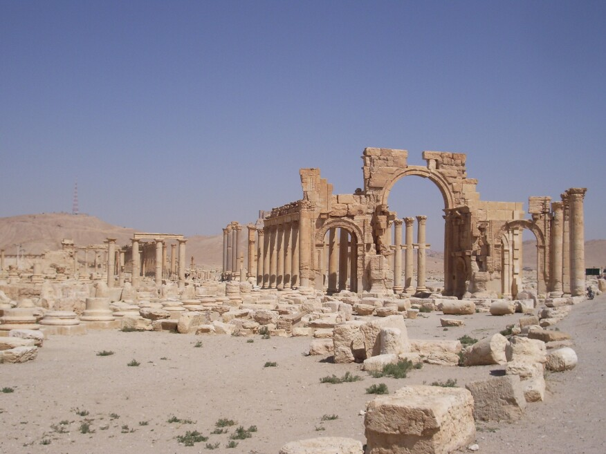 Ruins of the Roman triumphal arch at Palmyra as photographed in 2006.