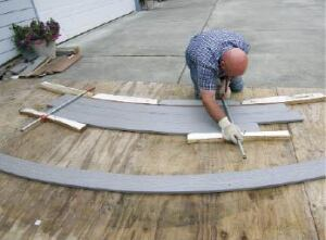 Figure 1. When building curved stairs, start with a full-scale layout on plywood. Use it as a template for bending tread stock and for noodling out dimensions.