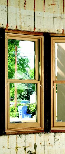 Lodgepole pine beams are lag bolted to embedded angle iron below the pocket in the ICF walls.