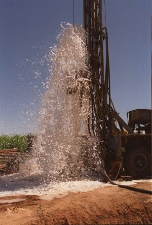 Foam pumps out of a borehole drilled by World Vision in Senegal.