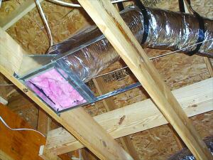 Straight Shooting: For best airflow, this duct is stretched to full length and well supported with no kinks or sharp bends. The temporary fiberglass plug will keep dirt out during construction.