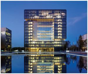 A nighttime exterior view of ThyssenKrupp Quarter, a corporate office building in Essen, Germany, was the winner of the 28th Annual GE Edison Award.