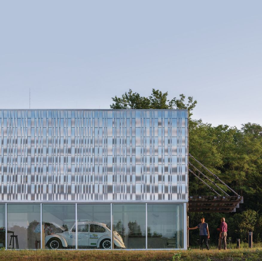 The main entrance to the EcoHawks facility is marked by a glass canopy with integrated photovoltaics from Suniva.