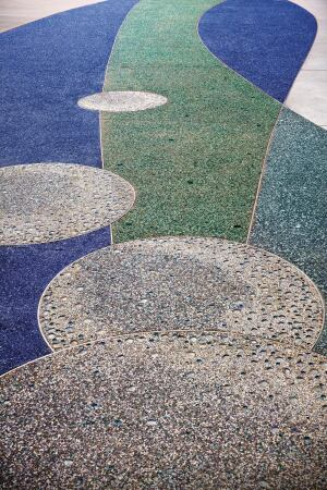 Lithocrete gives the concrete surface a colorful look. Crushed glass aggregate was used for the radiant color scheme.