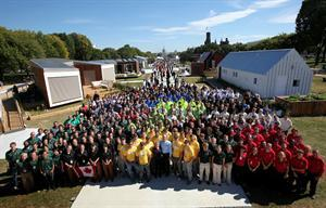 The 20 Solar Decathlon teams gather before the event's ribbon-cutting ceremony Oct. 8.