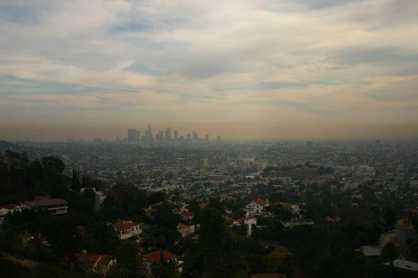 The present-day Los Angeles skyline beneath a film of smog.