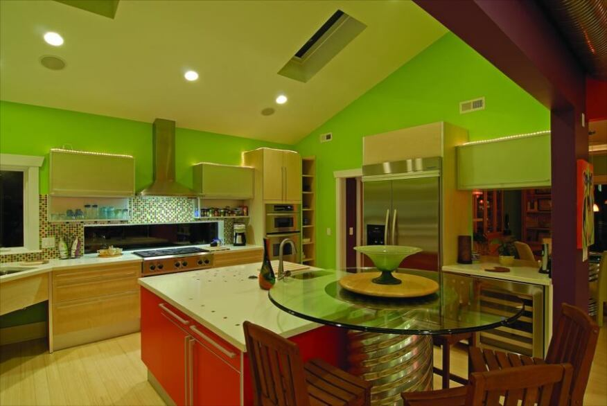 COLORFUL KITCHEN: The home's interior is a mix of bright colors that take advantage of ample natural light and an open floor plan.