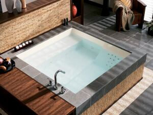 tranquility for two  The Consonance whirlpool comprises two distinct soaking areas and dual controls for a shared experience tailored to individual preferences. A raised bench along one side lets bathers cool off while still partially submerged. The tub reaches 70 inches square with a bathing depth of up to 19-1/2 inches of water. Drop-in deck mounting or undermount installations can be set in a corner or freestanding island. Kohler, 800.4.KOHLER; www.kohler.com