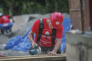 As part of a volunteer group, the author helps rebuild a school in Haiti.