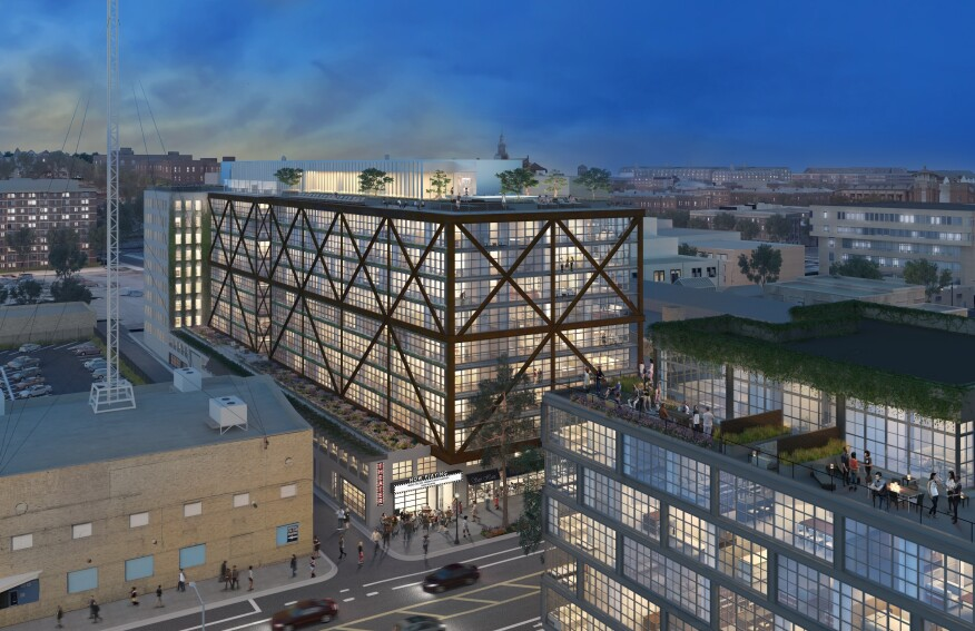 Fraternal twin buildings for apartments and condos are being developed at the site of the old Atlantic Plumbing factory on the edge of an up-and-coming neighborhood in DC. Image Courtesy The JBG Companies