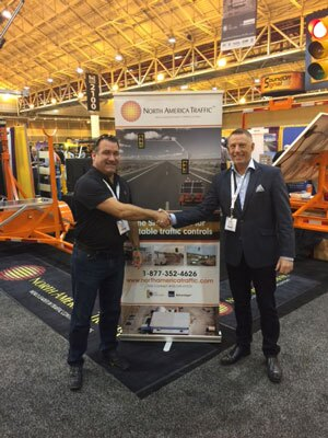 Peter Vieveen, President of North America Traffic (right), welcomes Star Smith, Vice President and COO of M&M Services, to the North America Traffic booth at the American Traffic Safety Services Association (ATSSA) 2016 Convention and Traffic Expo in New Orleans.