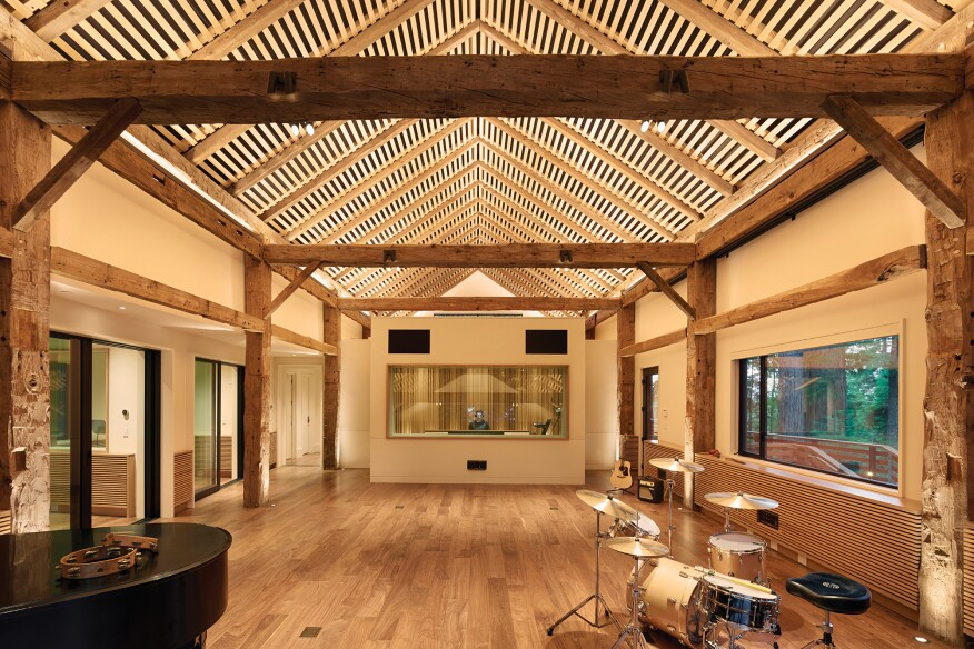 Layers of light bring out the architectural details of the studio and provide a creative setting. In-grade uplights highlight the texture of the axe-hewn timbers, while monopoints on the cross beams provide an accent of sparkle and tasklighting for the musicians.