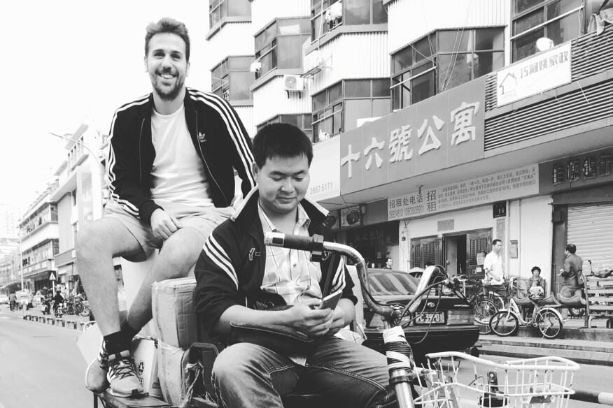 Giovanni (left) rides around Shenzhen collecting items for the 2015 Shenzhen Hong Kong Bi-City Biennale.