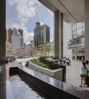 A sky garden located off of the retail podium. Glass doors, by Dorma and Kaba, grant access to the gardens.