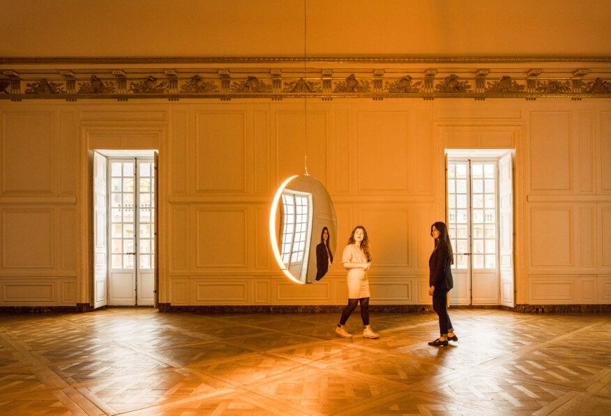 """Eliasson's """"Solar Compression"""" appears to float while lighting up a bare room inside the Palace of Versailles."""