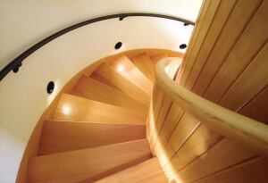"""nice curve  Items that will be touched assume a lofty position in architecture. Mahady exalts the curved handrail. """"The curved form of a handrail is completed by the grip of a hand,"""" she says. The handrail shown was custom fabricated by Dave Krueger for one of SALA's custom homes. David M. Krueger Construction, 360.298.0744."""