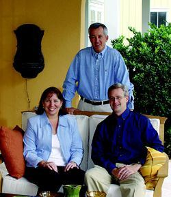 DEVELOPERS: The Baldwin Park development team, from left to right: Janet Morris, director of operations; David Pace, managing director (standing); Sean Lackey, town architect