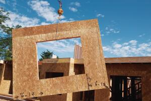 Panelized construction systems, such as this wall from Weyerhaeusers iLevel business, allow architects and builders to cut construction time, lower labor costs, and reduce waste.