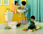 The rim height of Gerber's two-piece PeeWee toilet is 10 inches, similar to the height of child-sized toilets from other manufacturers. However, the side-to-side measurement is smaller. The PeeWee uses a standard rough-in, so as children grow, homeowners can replace it with a regular toilet.