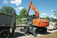 Reduced tail-swing excavator