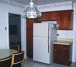 Contest entrants were faced with the challenge of transforming this outdated kitchen into a modern, family-friendly room.