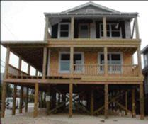 Piling it on jlc online foundation engineering for Raising a house on pilings