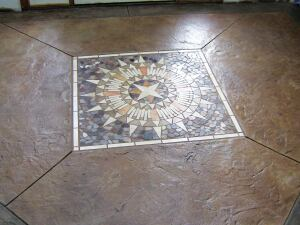 Starburst mosaic is the focal point of this stamped concrete interior entryway, created in the pentagon shape of baseball's home plate.
