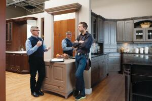 Kitchen designer Carlos Ponte (left), says creating a no-pressure relationship is key to winning over clients during a showroom visit.
