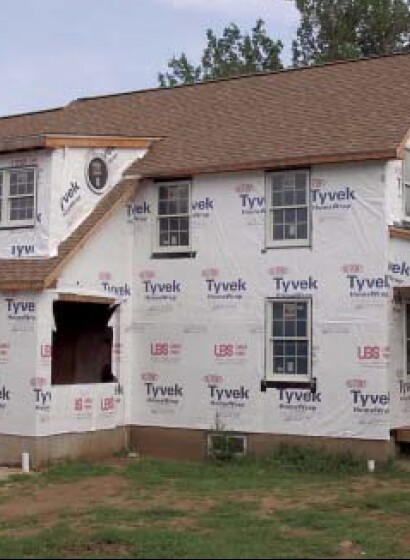 While foam is water resistant and provides a good barrier against the bulk of the weather, wind-driven rain can find its way around panels and through joints, so Caulkins relies on a housewrap and careful window flashing installed over a fully sheathed structure before installing the foam.