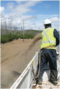 A crewmember applies the biotic-enriched hydraulic growth medium Biotic Earth along highly erodible, sandy roadside soil in northern Québec. For more on this product, visit www.bioticearth.com