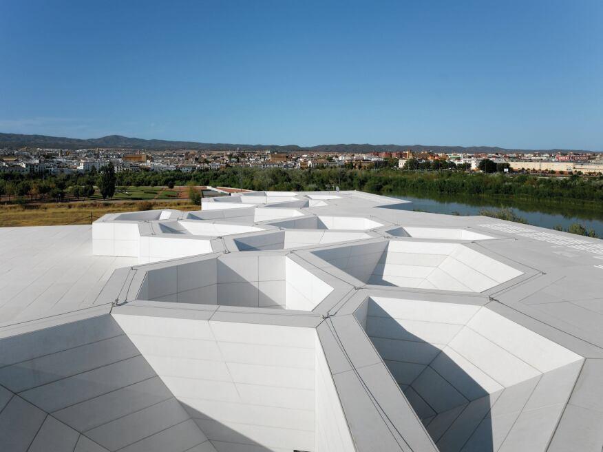 Glass-fiber-reinforced concrete panels clad the building roof.