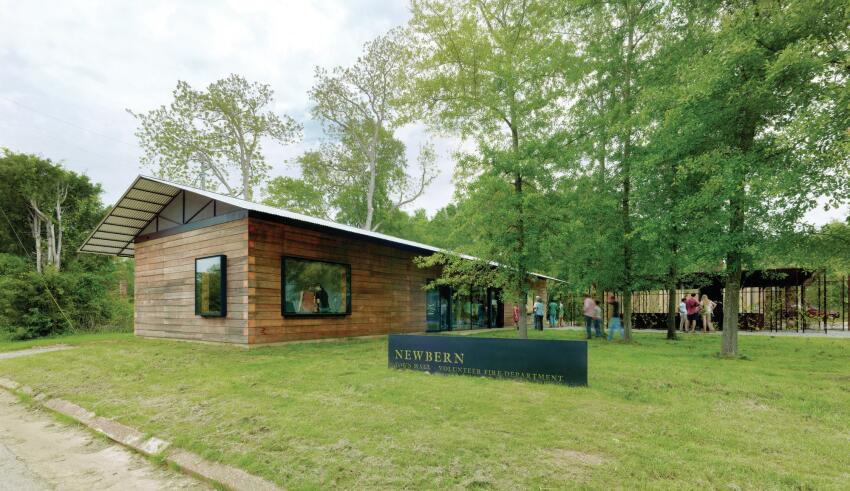 Designed and built by Rural Studio students in Newbern, Ala., the town hall is built out of stacked timbers. Sourced locally, the cypress beams were squared at 8 inches by 8 inches and are held together with a ½-inch threaded rod.