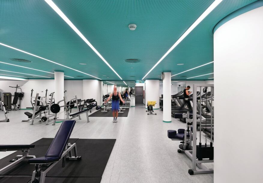 In the gym, low ceiling heights dictated a linear fluorescent fixture with an opal diffuser.